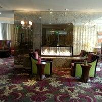 Photo taken at Kimpton Hotel Monaco Baltimore Inner Harbor by Jade H. on 10/22/2013