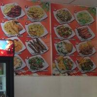 Photo taken at Dragon Garden Chinese Restaurant by Regina W. on 7/14/2013