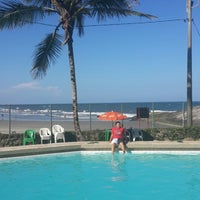 Photo taken at Caiobá Praia Hotel by Emanuel M. on 2/1/2014