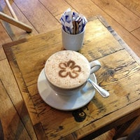 Photo taken at Accents Coffee & Tea Lounge by Niamh C. on 4/24/2014