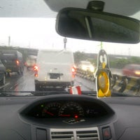Photo taken at Gerbang Tol Kamal by Megawaty Novia Herlina on 6/5/2014