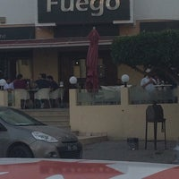 Photo taken at Fuego by Tharwiitaa M. on 10/18/2014