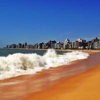 Photo taken at Praia da Costa by Gabriel L. on 11/24/2012