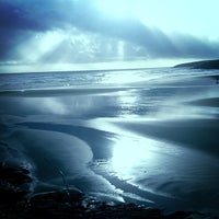 Photo taken at Inchydoney Beach by Pat C. on 12/16/2012