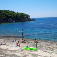 Photo taken at Srebrena beach by FlyerZ B. on 8/5/2014