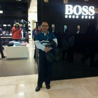 Photo taken at BOSS Store by dq y. on 11/11/2012