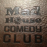 Photo taken at Mad House Comedy Club by Kira F. on 2/23/2012
