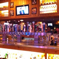 Photo taken at Miller's Ale House by Adriano M. on 8/13/2012