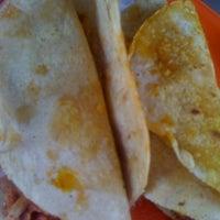 Photo taken at Tacos De Cochinita Don Roger by Viktor M. on 2/20/2012