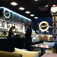 Photo taken at Laima Cafe by Aljona P. on 2/20/2012