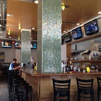 Photo taken at The Over/Under Bar & Grill by Fiona B. on 7/5/2012