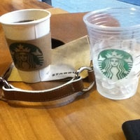 Photo taken at Starbucks by Jenny B. on 3/24/2012