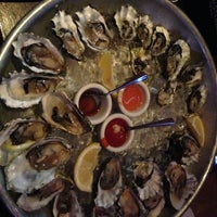 Photo taken at Mayes Oyster House by Diana H. on 3/10/2013
