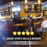 Photo taken at The Library Sports Grill and Brewery by Chris S. on 7/5/2014
