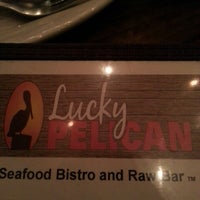 Photo taken at Lucky Pelican Bistro by Addie W. on 4/21/2013