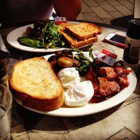 Photo taken at Gusto Deli Cafe by Mark T. on 4/24/2014
