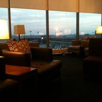 Photo taken at British Airways Galleries Lounge by Anna W. on 12/15/2012