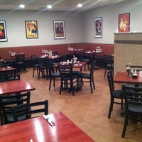 Photo taken at Amore Pizzeria & Cafe by Amore Pizzeria & Cafe on 5/20/2014