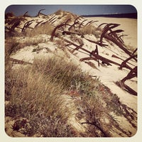 Photo taken at Praia do Barril by Paulo T. on 2/6/2013