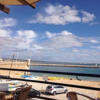 Photo taken at Praia da Batata by Ila on 10/7/2015