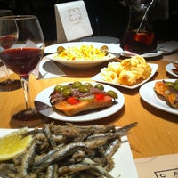 Photo taken at Cerveseria Catalana by Alice T. on 12/8/2012