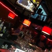 Photo taken at Iris Lounge by Kyle S. on 12/30/2012