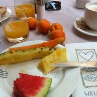 Photo taken at Laguna Palace Hotel by Teresa R. on 7/29/2012