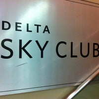 Photo taken at Delta Sky Club by Ben E. on 12/17/2012