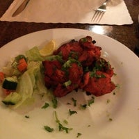 Photo taken at Bombay Bistro by Moe T. on 7/23/2014