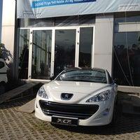 Photo taken at Ünallar Otomotiv Peugeot by Mehmet H. on 5/4/2012