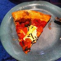 Photo taken at Mellow Mushroom by Ryan G. on 8/3/2012