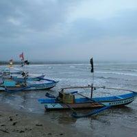 Photo taken at Pantai Ujung Genteng by KutilangDara C. on 11/20/2014