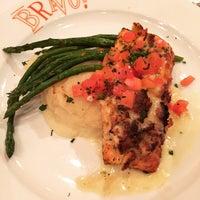Photo taken at BRAVO! Cucina Italiana by Erica C. on 4/1/2015