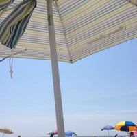 Photo taken at 76th Street Beach by Jason M. on 7/7/2014