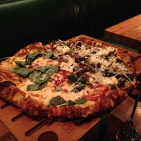 Photo taken at La Grande Orange Grocery & Pizzeria by Frank D. on 4/9/2013