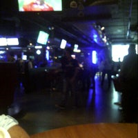 Photo taken at Underdoggs Sports Bar & Grill by Sumit G. on 10/12/2012