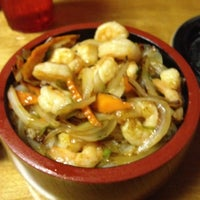 Photo taken at Juno's Sushi Steak & Seafood by Lisa R. on 6/23/2012