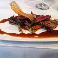 Photo taken at Zebra Restaurant & Wine Bar by heather a. on 2/20/2012
