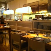 Photo taken at Wolfgang Puck Bar & Grill by Cindy R. on 2/4/2012