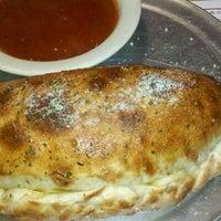 Photo taken at Monty's Pizza by Regena on 1/12/2012