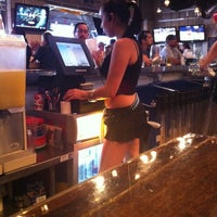 Photo taken at Ojos Locos Sports Cantina by Tom C. on 3/14/2012