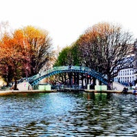 Photo taken at Canal Saint-Martin by Andrea A. on 3/25/2012