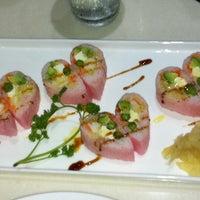 Photo taken at Fusion Fire Asian Fondue & Sushi Bar by Chelsie K. on 9/9/2011