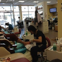Photo taken at Nice One Nails & Tanning by Michelle M. on 3/16/2012