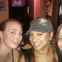 Photo taken at Sports Page Bar & Grill by Erin D. on 9/29/2011