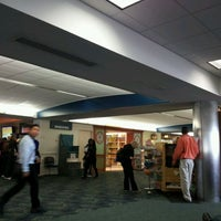 Photo taken at Gate E5 by Cecile D. on 12/24/2011
