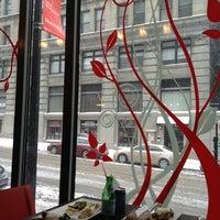 Photo taken at Café Santé Veritas by Jessie D. on 3/1/2012