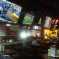 Photo taken at Buffalo Wild Wings by Thomas B. on 7/14/2012