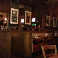 Photo taken at Descanso Latin American Restaurant, Bar & Grill by Elena F. on 12/11/2011
