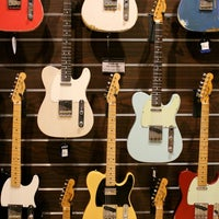 Photo taken at Cosmo Music - The Musical Instrument Superstore! by Christopher B. on 2/16/2012